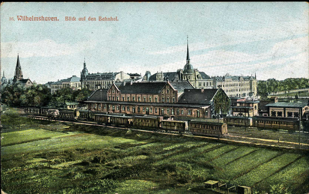 Diese alte Lithographie zeigt den Bahnhofsbereich in den 1890er Jahren. Interessant die zahlreichen unterschiedlichen Waggons im Gleisbereich.